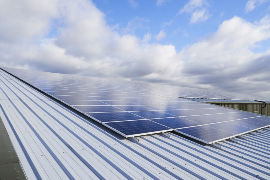 View of large solar panel array on top of an Anglian Water facility